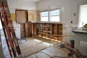 A room is ripped up to prepare for a remodel.
