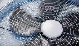 A picture of fans spinning in an AC unit.
