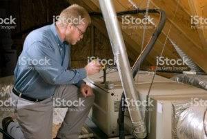 An HVAC technician performs an inspection.