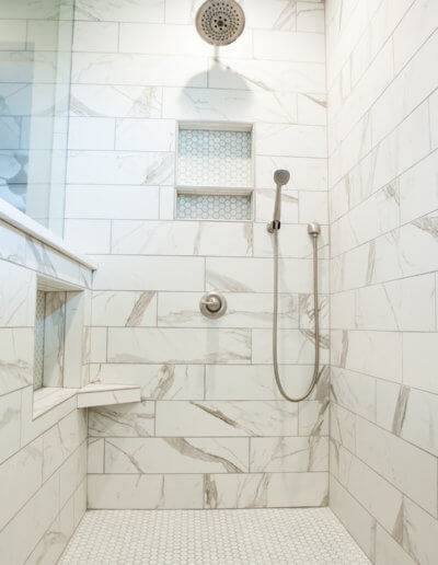 A new, white marbled shower.