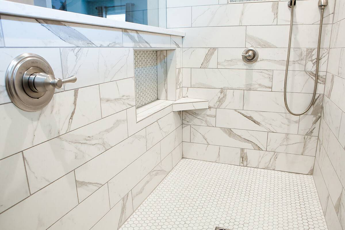 A view of the new white marble shower.