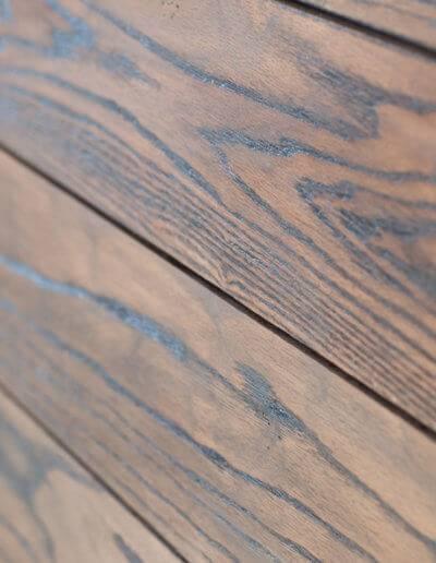 New wood paneling on a bathroom wall.