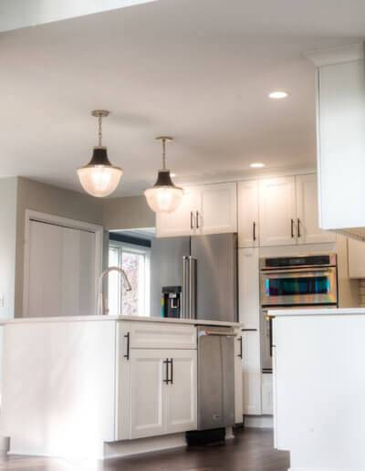 kitchen island with two enclosed pendent lights