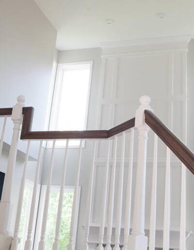 custom brown hand railing on a staircase