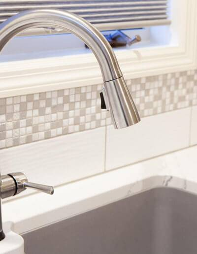 A new faucet for the kitchen sink.