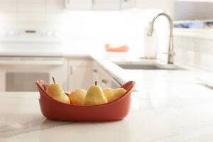 A fruit bowl atop new counters.