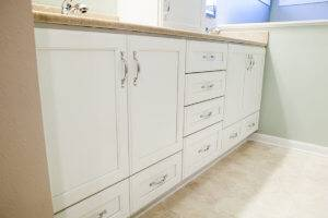 Westbend Bathroom white cabinets.