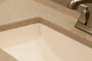 A close-up photo of a faucet and sink.
