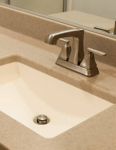 Countertops and a white sink.