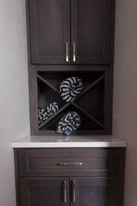 New cabinetry with built-in towel rack.