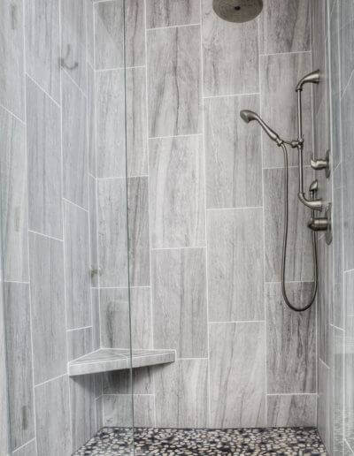 A newly-installed shower with detailed tiling.