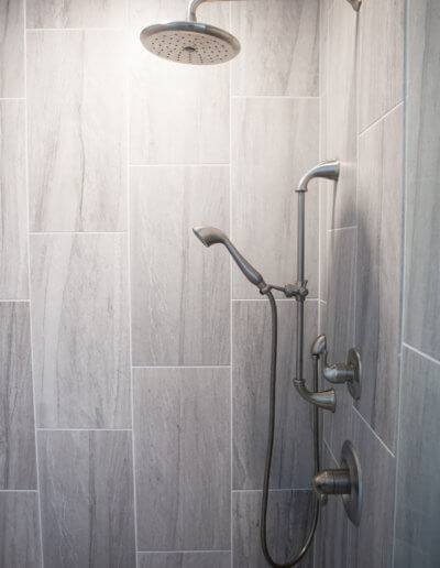 A waterfall shower head and a removable sprayer.