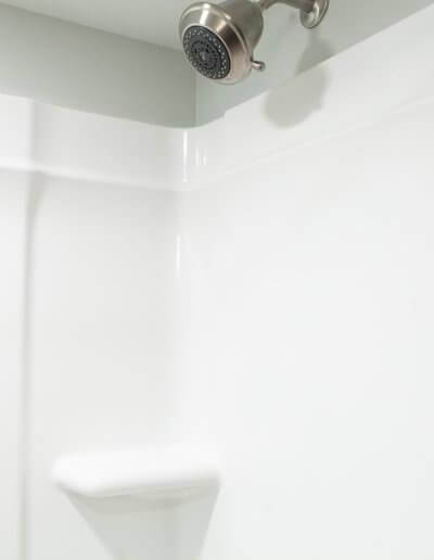 A photo of a white shower stall.