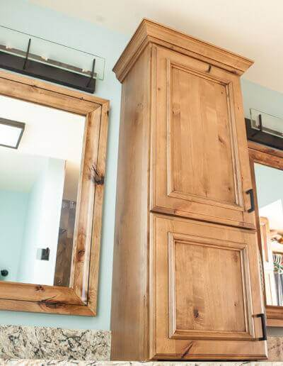 bathroom his and her vanity mirrors with wooden storage cabinets between