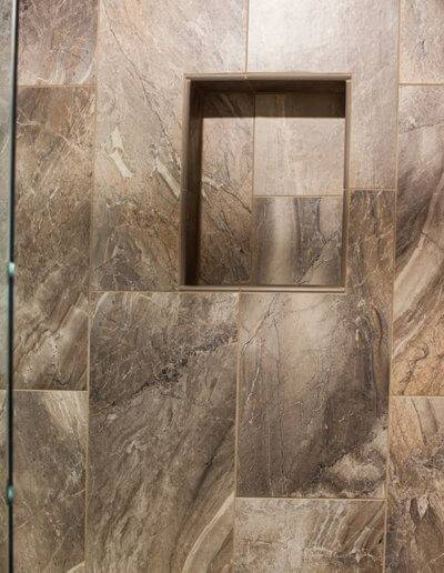 walk-in shower with built-in shelf