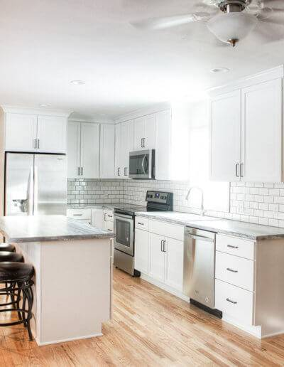 kitchen remodel with and island and subway tile backsplash