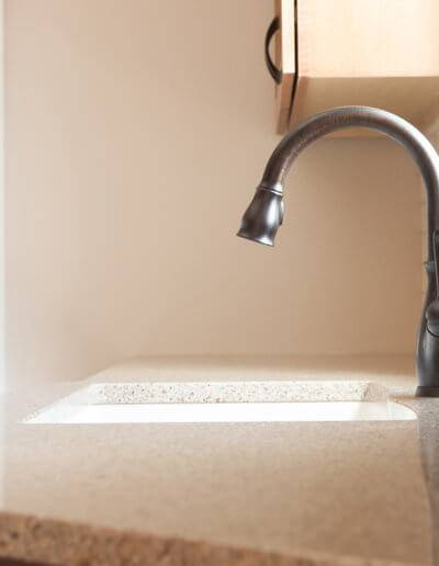 Side view of a kitchen sink faucet