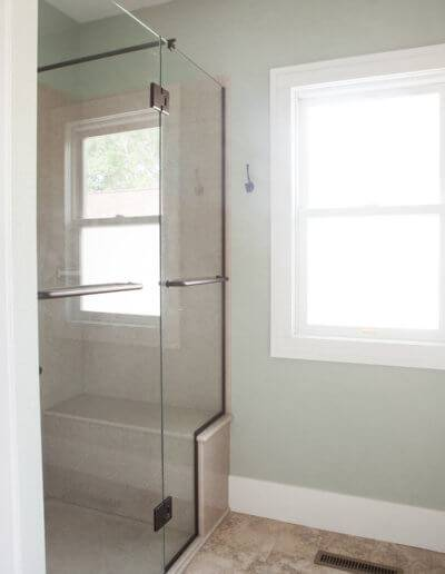 walk-in shower with full glass door on hinges