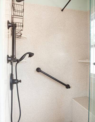 walk-in shower with bench and shower head and sprayer combo