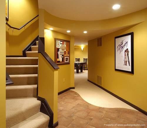 A finished basement with yellow walls and a Dirty Dancing poster on the wall.