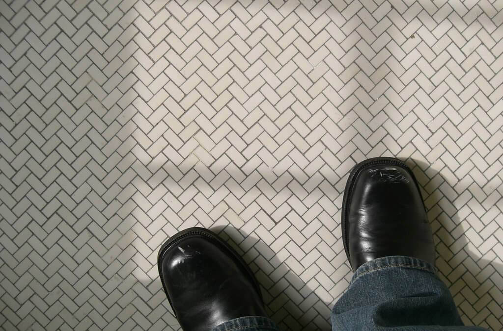 White chevron tile floor with shoes.