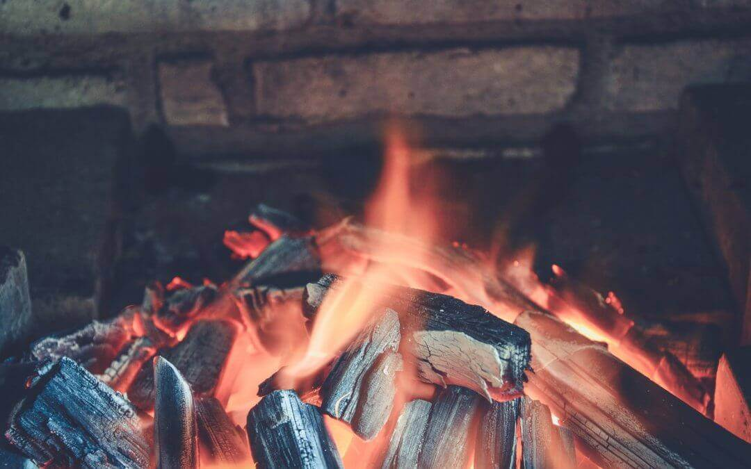 A photo of a fire in a fireplace.