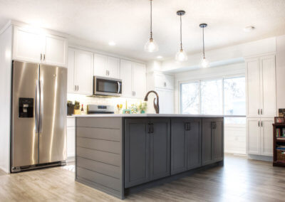 remodeled kitchen featuring a large island and windows letting in natural light
