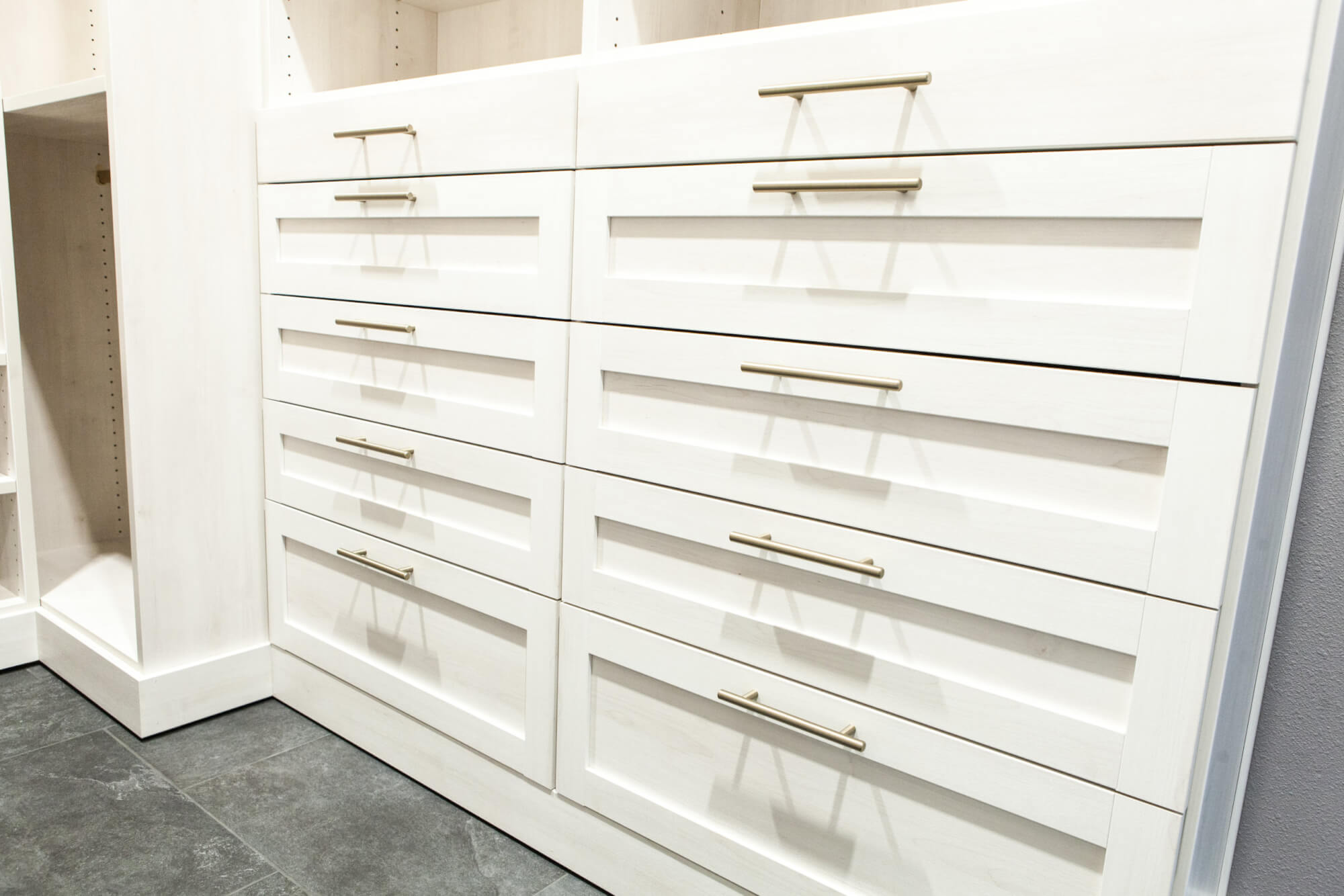 up close of custom clothing drawers in a walk-in bathroom closet