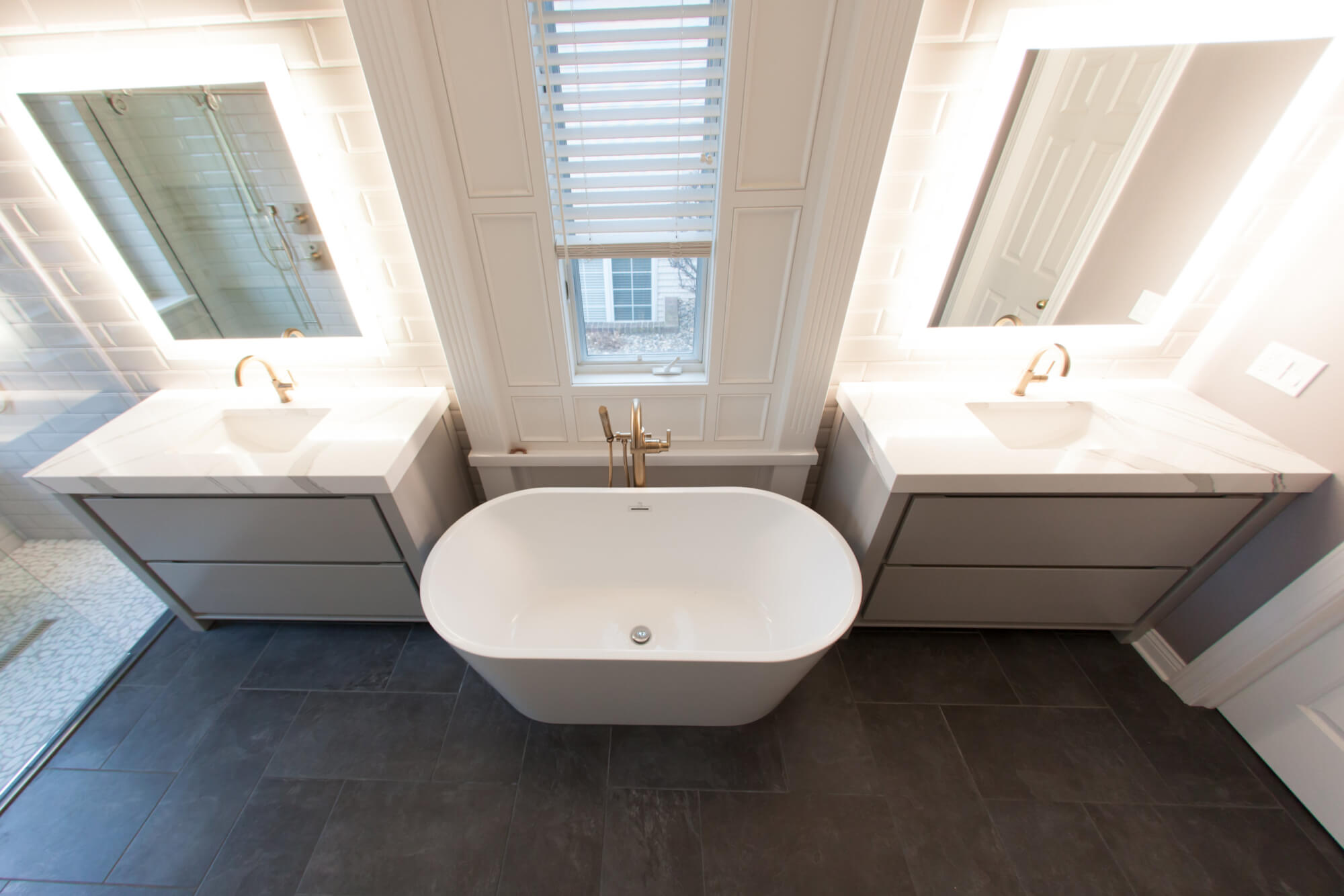 top view of a drop-in bathtub placed between a his and her vanity set