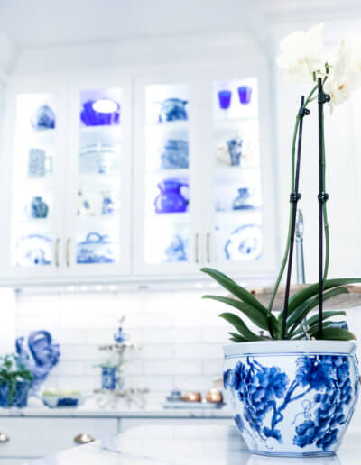 white cabinet shelves with blue and white china