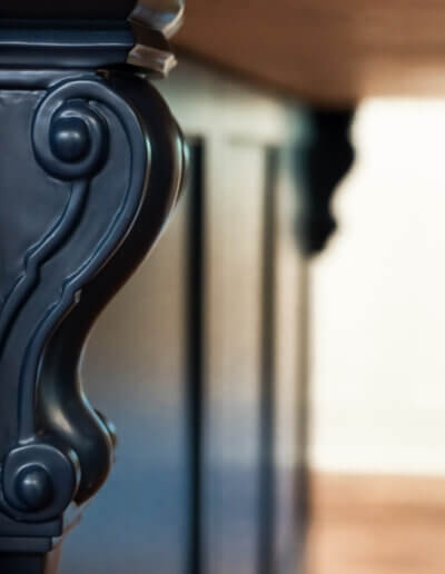 """close up of """"violin-like"""" detail on kitchen island supporting countertop"""