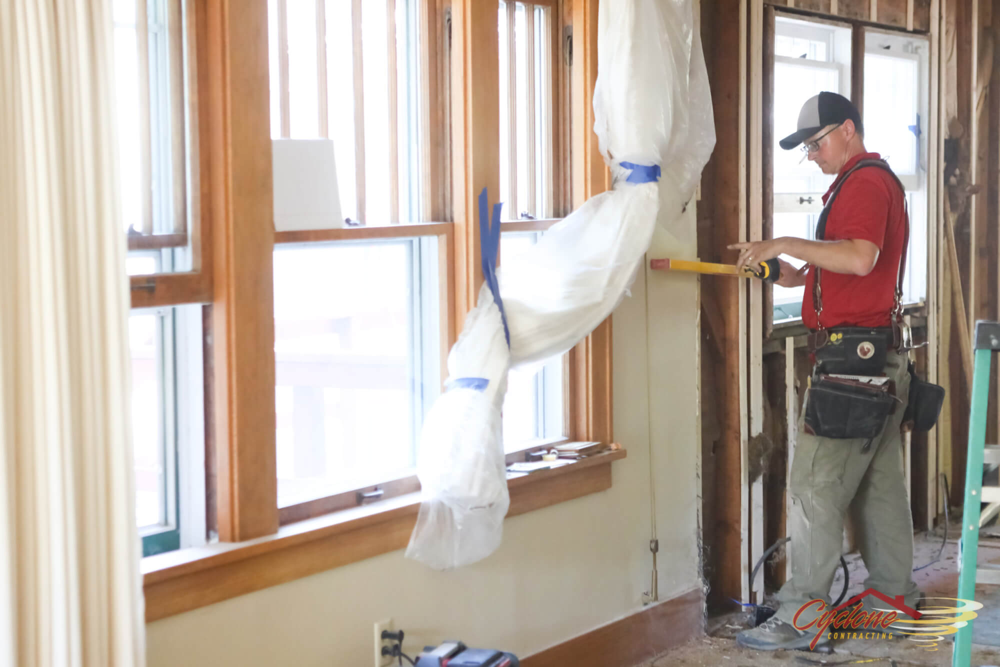A Cyclone Contracting Remodeling Technician Remodels A Home in Ames, IA