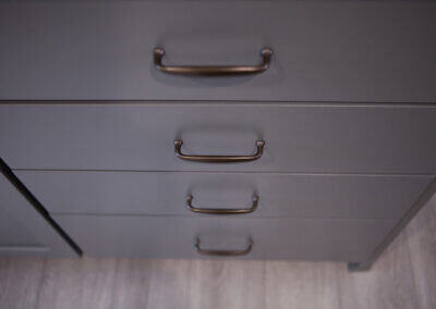 down shot of gray drawers with black metal pulls