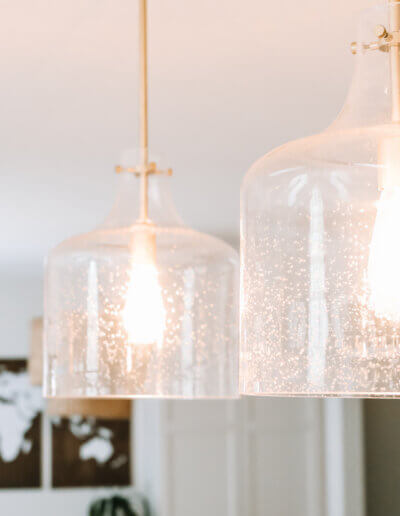close detailed view of glass pendants above kitchen island