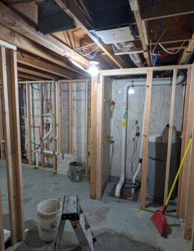 old basement with exposed drywall and wooden beams