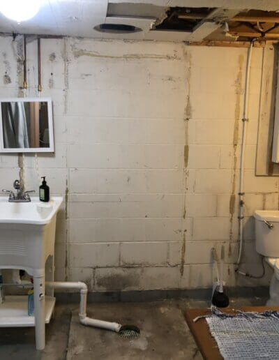 old bathroom with dirty wall and ceiling